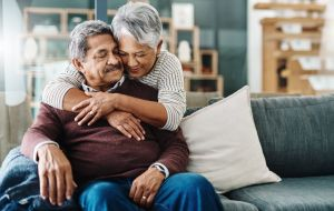 family caregiver hugging a man with dementia