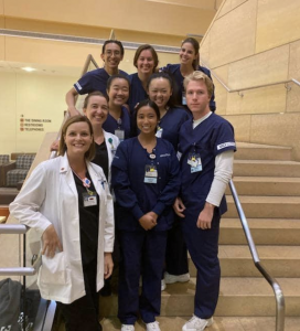 pre-licensure program director dr leanne burke EdD at uci school of nursing with some of her students