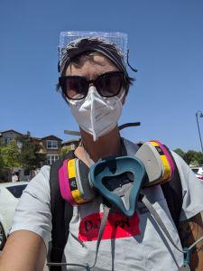 nurse danisha jenkins wearing a gas mask at a protest