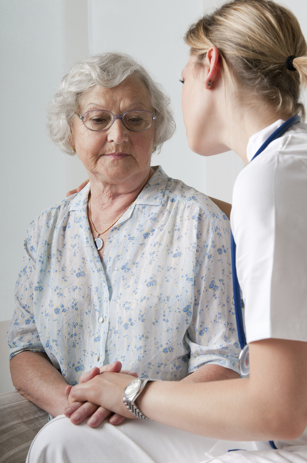 senior woman going through stress and trauma receiving care from a nurse