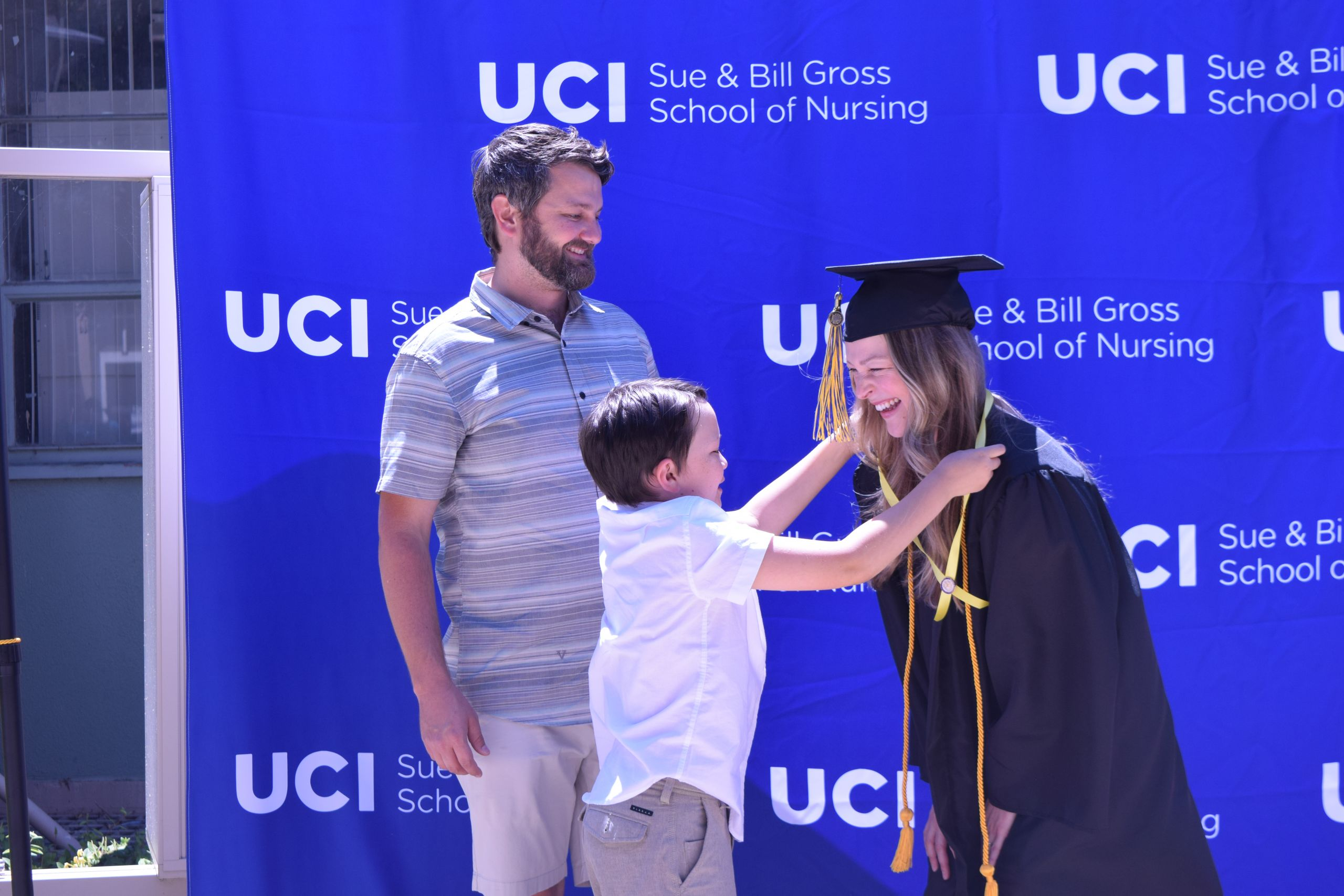 uc irvine school of nursing class of 2021 graduate commencement miranda apalategui and her son and husband at pinning ceremony
